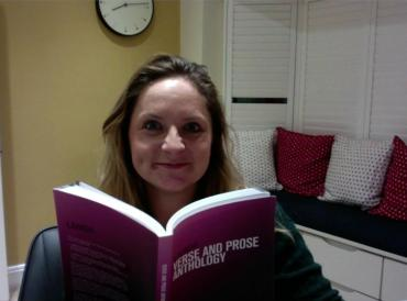 LAMDA teacher Jo O'Ferrall sitting at home with a LAMDA syllabi