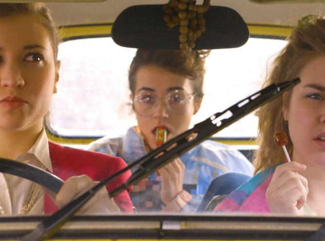 Three LAMDA students sitting in a car, taken from short film The Club