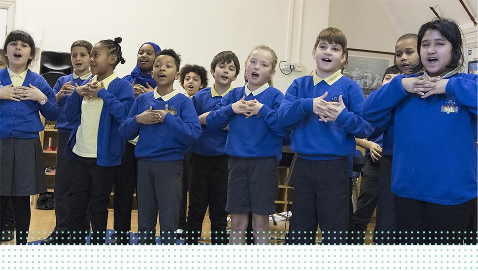 A group of LAMDA learners singing in rehearsal